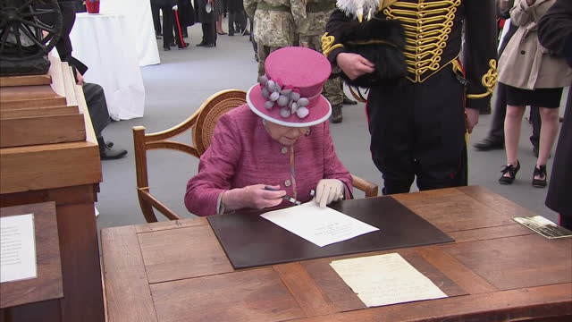 exterior shots her majesty the queen marks 70 years of the king's troop royal horse artillery the queen sits down and signs paper at reception of the... - royal horse artillery stock videos and b-roll footage