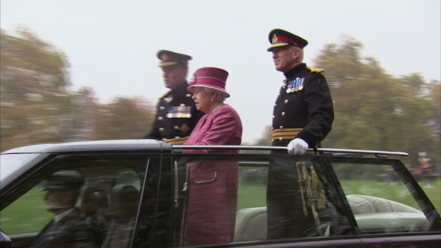 exterior shots her majesty the queen marks 70 years of the king's troop royal horse artillery the queen steps into range rover car and stands in... - royal horse artillery stock videos and b-roll footage