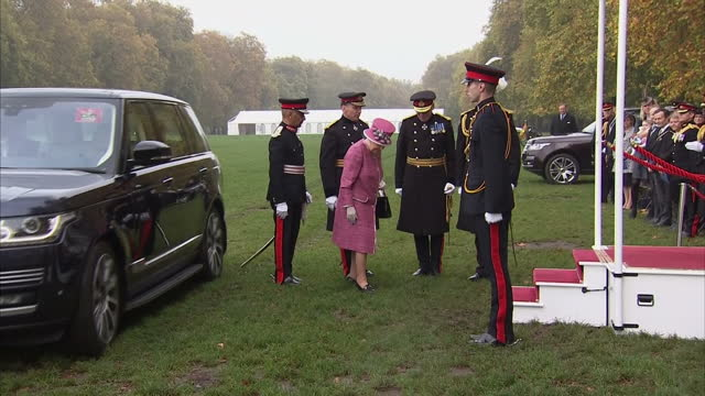 exterior shots her majesty the queen marks 70 years of the king's troop royal horse artillery the queen arrives in range rover car and steps out to... - royal horse artillery stock videos and b-roll footage