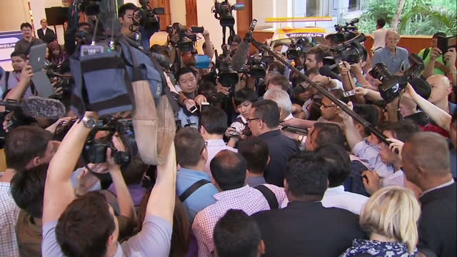 exterior shots hishammuddin hussein malaysian defence minister and former transport minister whispering secretively to man / exterior interview... - whispering stock videos and b-roll footage