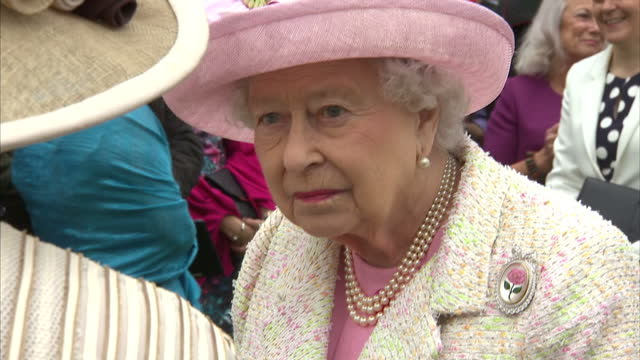 exterior shots hm queen elizabeth ii and prince philip duke of edinburgh meeting gueast at garden party at the palace of holyroodhouse on july 04... - palace stock videos & royalty-free footage