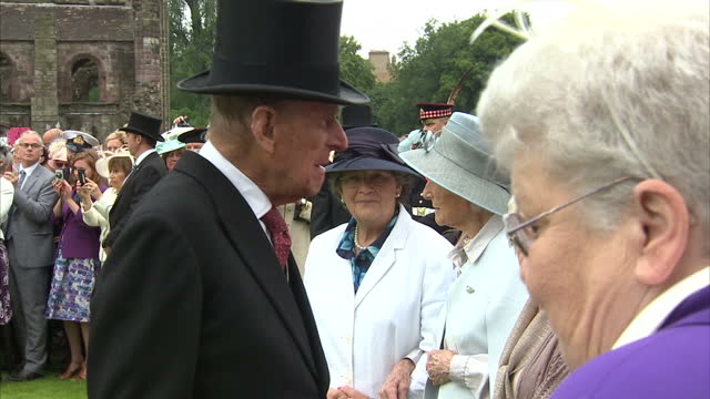 Exterior shots HM Queen Elizabeth II and Prince Philip Duke of Edinburgh meeting guests at Garden Party At The Palace Of Holyroodhouse on July 04...