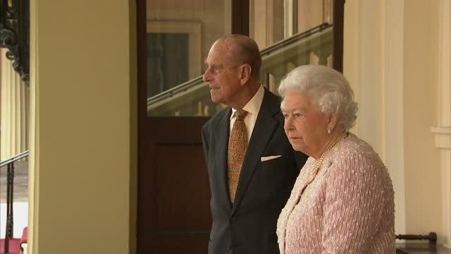 exterior shots hm queen elizabeth ii and prince philip duke of edinburgh outside buckingham palace on march 05, 2015 in london, england. - duke of edinburgh stock videos & royalty-free footage