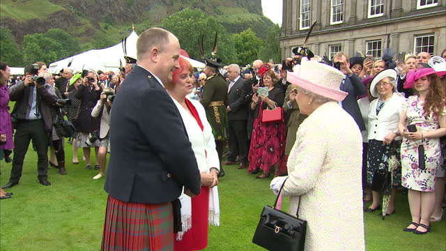 exterior shots hm queen elizabeth ii meeting guests at garden party at the palace of holyroodhouse on july 04 2017 in edinburgh scotland - palace stock videos & royalty-free footage