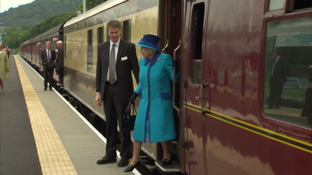 Exterior shots HM The Queen Elizabeth II and Prince Philip Duke of Edinburgh First Minister Nicola Sturgeon arriving at Tweedbank Station in Steam...