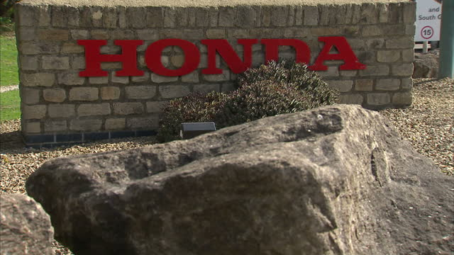 exterior shots honda car plant in swindon showing signs plant map honda is having to to halve production of its uk factory because of a shortage of... - honda stock videos & royalty-free footage