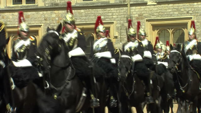 exterior shots horse guards ceremonial parade at windsor castle prince andrew duke of york and sheikh khalifa bin zayed al nahyan watching on uae... - 騎兵隊点の映像素材/bロール