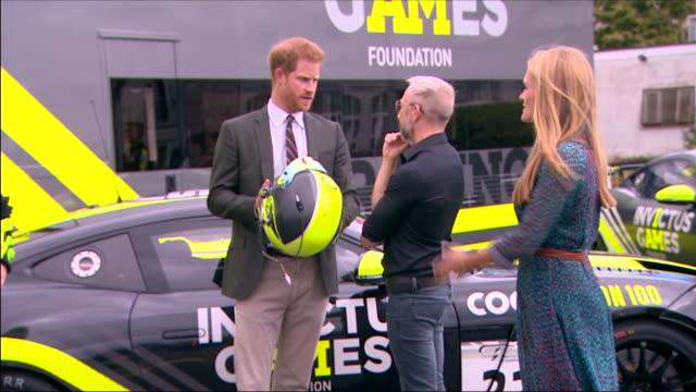 exterior shots hrh prince harry, duke of sussex during his visit to the royal marines commando training centre, looking at a car that has been... - royal marines stock videos & royalty-free footage