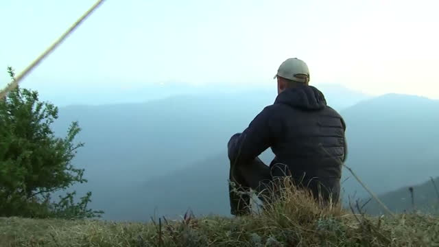 exterior shots hrh prince harry watches the sun rise after spending the night in the himalayan hilltop village of leorani on day four of his visit to... - nepal stock videos & royalty-free footage