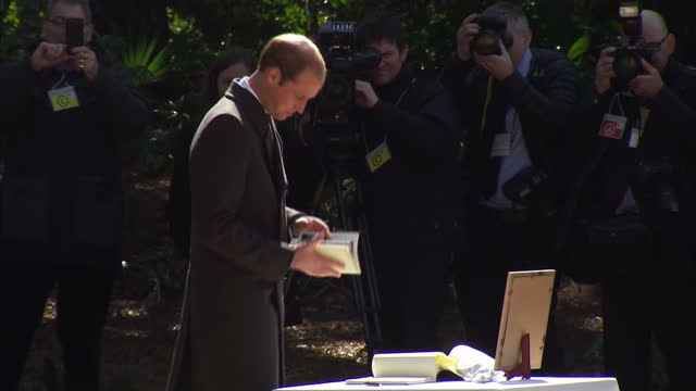 exterior shots hrh prince william duke of cambridge signs condolence book and looking at picture of his late mother diana the hodogaya commonwealth... - war stock-videos und b-roll-filmmaterial