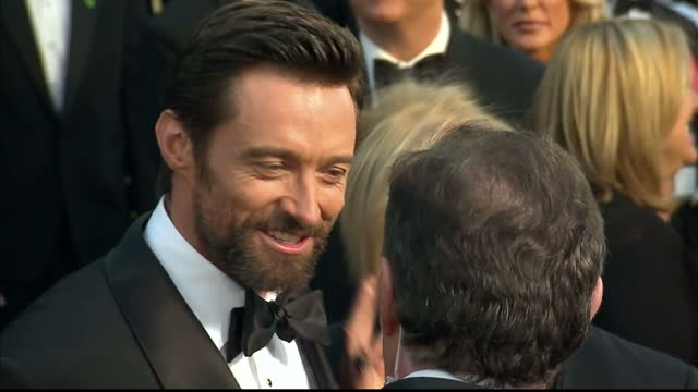 Exterior shots Hugh Jackman chats to reporters on the red carpet Hugh Jackman on the Red Carpet at Dolby Theatre on February 25 2013 in Hollywood...
