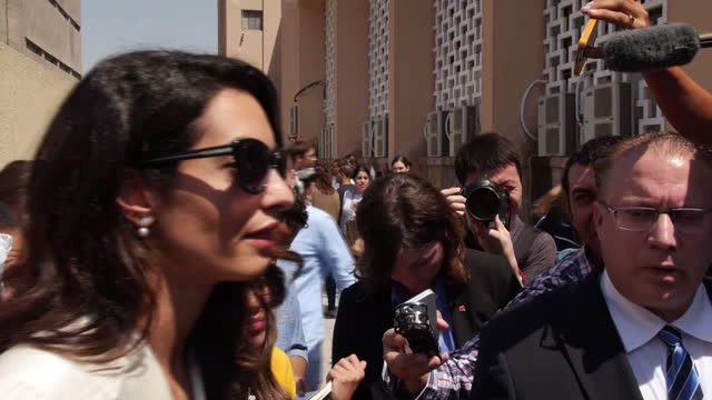 Exterior shots Human Rights Lawyer Amal Clooney in media scrum after court verdict in Al Jazeera Journalists Trial on August 29 2015 in Cairo Egypt