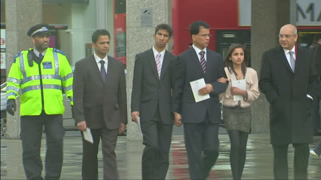 exterior shots husband & family of jacintha saldanha arrive at westminster cathedral for mass family of jacintha saldanha arrive for mass on december... - westminster cathedral stock videos & royalty-free footage