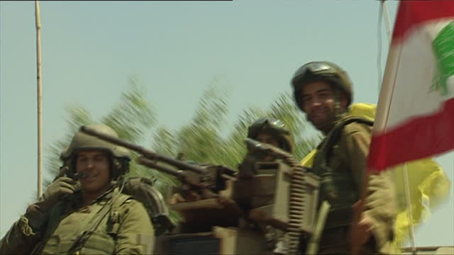 exterior shots idf at israel lebanon border israeli soldiers waving captured lebanon and hezbollah flags on july 24 2006 in unspecified israel - 2006 stock videos & royalty-free footage