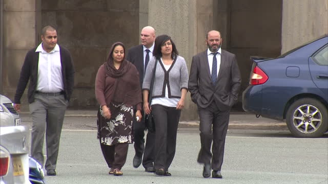 stockvideo's en b-roll-footage met exterior shots iftikhar ahmed & farzana ahmed, parents accused of murdering shafilea ahmed walk into chester crown court. shafilea ahmed's parents at... - chester engeland