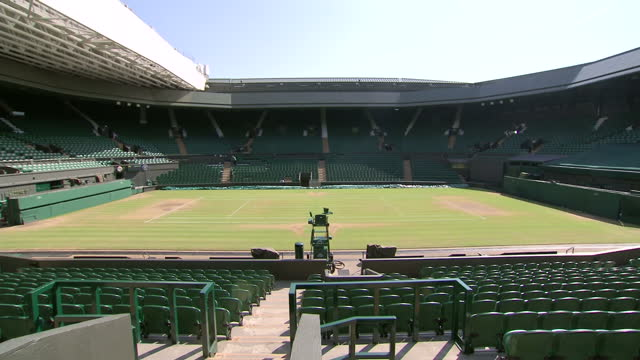 Exterior shots inside empty Centre Court at Wimbledon close ups of the grass and the number 77 seat Sunny Centre Court at Wimbledon at Wimbledon on...