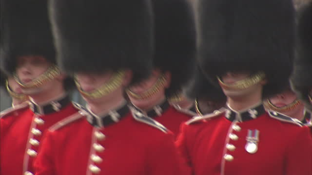 exterior shots irish guards practising marching in formation around parade ground being marshalled by drill instructor royal wedding preparations... - drill instructor stock videos & royalty-free footage
