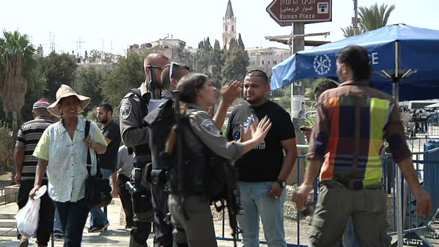 Exterior shots Israeli police officers stopping Palestinian citizens heading towards Damascus Gate and checking identification papers on October 05...