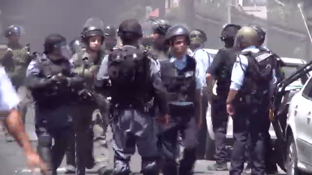 Exterior shots Israeli riot police on horse back exterior shots Israeli police security forces escort man with face covered during arrest amid...