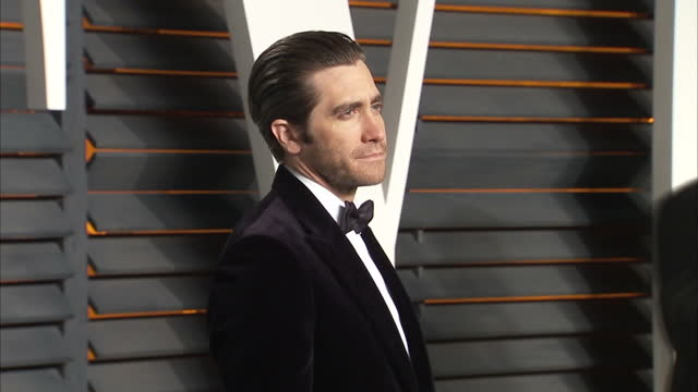 exterior shots jake gyllenhaal actor on vanity fair red carpet posing for photographers on february 28 2016 in hollywood california - jake gyllenhaal stock videos & royalty-free footage
