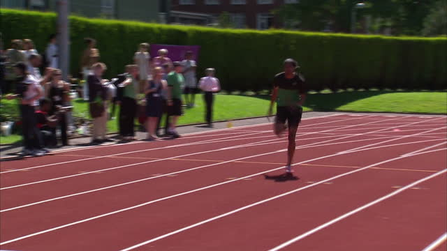 exterior shots jamaican 4 x 400m runner jermaine gonzalez in training at the university of birmingham athletics track sky news 2012 olympics coverage... - athleticism stock videos & royalty-free footage