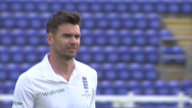 exterior shots james anderson, england cricket player walking across pitch at swalec stadium for team photo ahead of first ashes test match. on july... - チーム写真点の映像素材/bロール