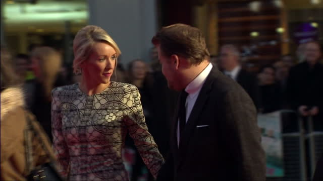 Exterior shots James Corden with wife Julia Carey signing autographs James Corden With Wife On Red Carpet at Leicester Square on October 17 2013 in...