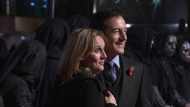 exterior shots jason isaacs his wife emma hewitt pose on the red carpet at the premiere of the harry potter the deathly hallows jason issacs on the... - jason isaacs stock videos & royalty-free footage