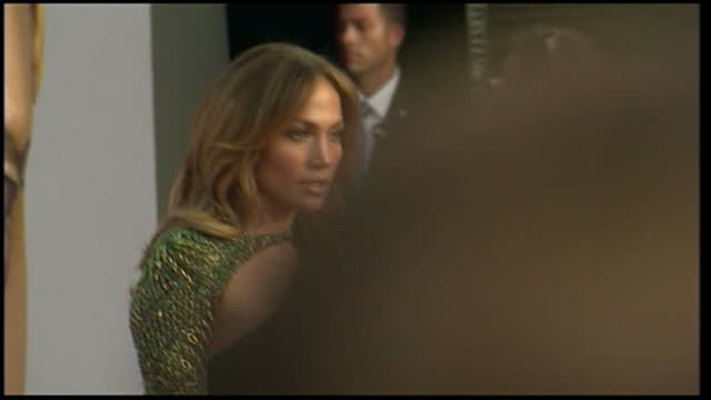 stockvideo's en b-roll-footage met exterior shots jennifer lopez walks on the red carpet at the bafta dinner to honour british talent in hollywood jennifer lopez arrives at red carpet... - jennifer lopez