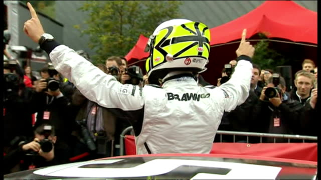 exterior shots jenson button putting his crash helmet on and gets into car to take competition winners around bluewater shopping centre. jenson... - protective sportswear stock videos & royalty-free footage