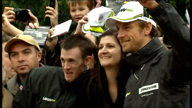 Exterior shots Jenson Button signing autographs and posing for photographs with fans on visit to Bluewater shopping centre Jenson Button has just won...