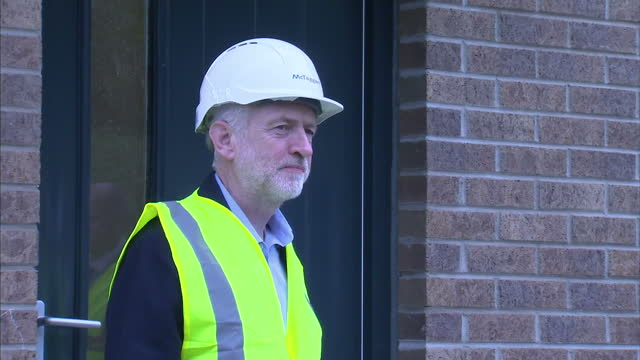 Exterior shots Jeremy Corbyn MP Labour Leader on visit to new homes building site wearing high visibility jacket and hardhat on October 10 2015 in...
