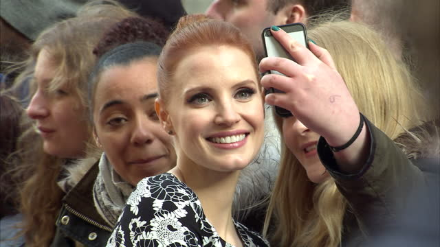 Exterior shots Jessica Chastain on Empire Awards red carpet signing autographs and posing for photos with fans on March 29 2015 in London United...