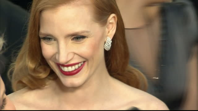 Exterior shots Jessica Chastain walks along the red carpet chatting with the media Jessica Chastain Walks the Red Carpet at Dolby Theatre on February...