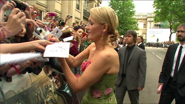 exterior shots jk rowling signs autographs for fans before posing for the press on the red carpet at the harry potter the deathly hallows part 2... - j.k. rowling stock videos and b-roll footage
