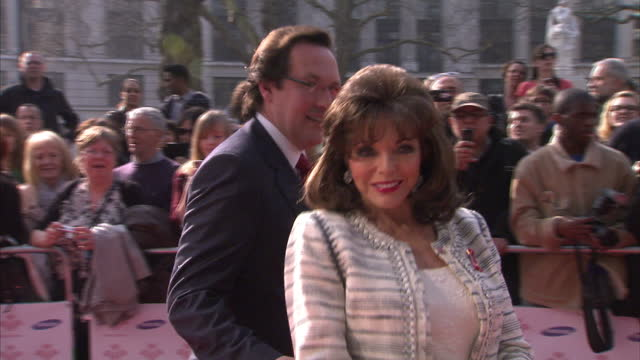 Exterior shots Joan Collins arrive on red carpet poses for photographs on March 12 2014 in London England