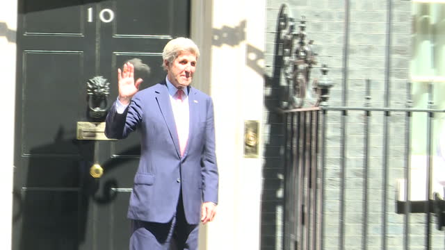 Exterior shots John Kerry exits 10 Downing Street speaks to waiting press pack and waves goodbye