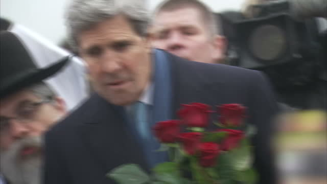 Exterior shots John Kerry with Patriarch Filaret arrive at scene to lay flowers at floral tribute in Independence Square on March 04 2014 in Kyiv...
