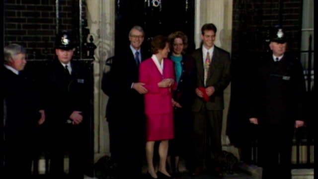exterior shots john major prime minister posing for the press outside downing street with wife norma major after winning the 1992 general election on... - john major stock-videos und b-roll-filmmaterial