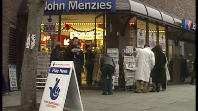 exterior shots john menzies newsagent shop on hampstead road customers outside look at national lottery tickets on november 18 1994 in london england - lottery stock videos and b-roll footage