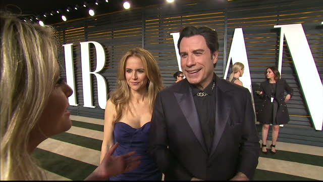 Exterior shots John Travolta and Kelly Preston talking to press on February 22 2015 in Los Angeles California