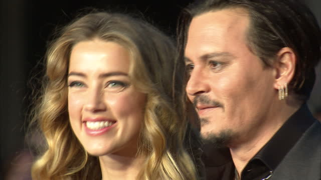 Exterior shots Johnny Depp actor and wife Amber Heard on red carpet at London Premiere of Black Mass on October 11 2015 in London England