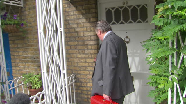 exterior shots justice secretary ken clarke walks out from his london home is greeted by a throng of press asking him questions about prison... - verurteilung stock-videos und b-roll-filmmaterial