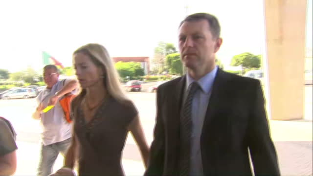 exterior shots kate and gerry mccann arrive at portuguese court to deliver personal statements at the trial of goncalo amaral, who they are suing for... - madeleine mccann stock videos & royalty-free footage