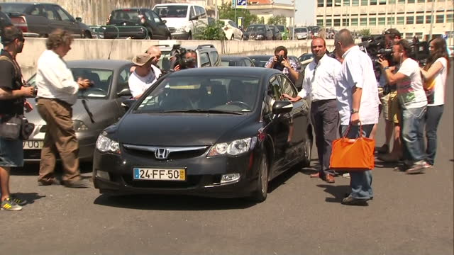 exterior shots kate and gerry mccann departing portuguese court after giving statements at the trial of goncalo amaral, who they are suing for libel... - gerry mccann stock-videos und b-roll-filmmaterial
