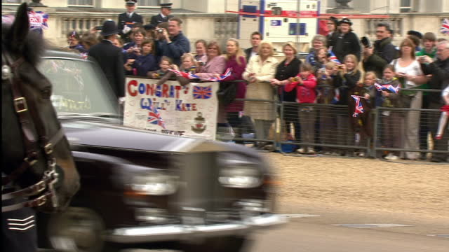 exterior shots kate middleton journeys with her father michael in rolls royce along the mall, horseguards & whitehall waving at the crowds lining the... - rolls royce stock videos & royalty-free footage