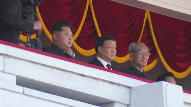Exterior shots Kim JongUn North Korean Leader sitting next to Chinese Politburo standing committee member Liu Yunshan watching Workers Party 70th...