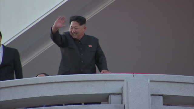 exterior shots kim jongun north korean leader waving to crowds and hold up arms with chinese politburo standing committee member liu yunshan after... - parade stock videos & royalty-free footage