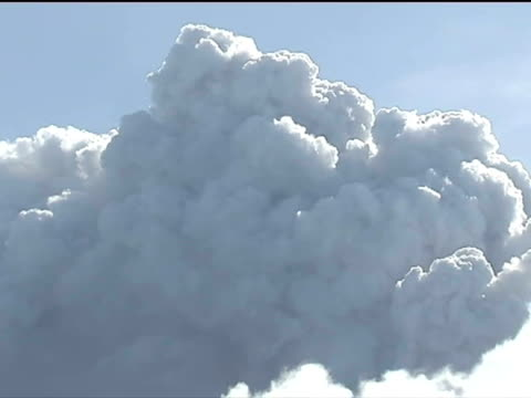 exterior shots large ash cloud above mountain moving across the sky forecasters are warning the cloud of volcanic ash over europe could reach the... - ash stock videos & royalty-free footage
