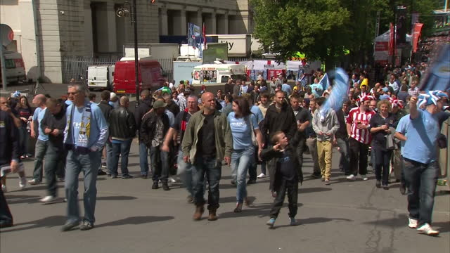 exterior shots large crowds of both manchester city & stoke city fans walking through the streets outside wembley stadium fa cup final fans outside... - wembley stadium stock videos & royalty-free footage